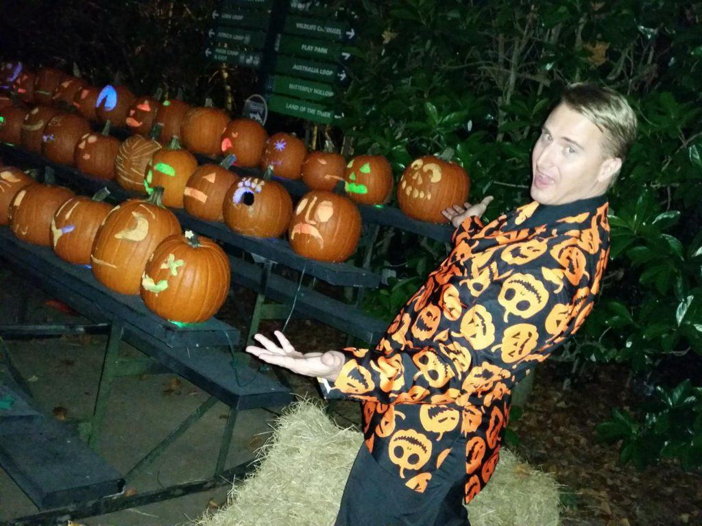 good looking man in a pumpkin suit